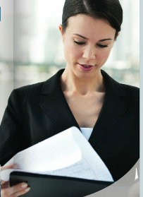 Woman in black suit jacket reading documents