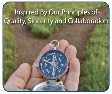 Hand holding compass at a crossroad. Inspired by our principles of quality, sincerity and collaboration
